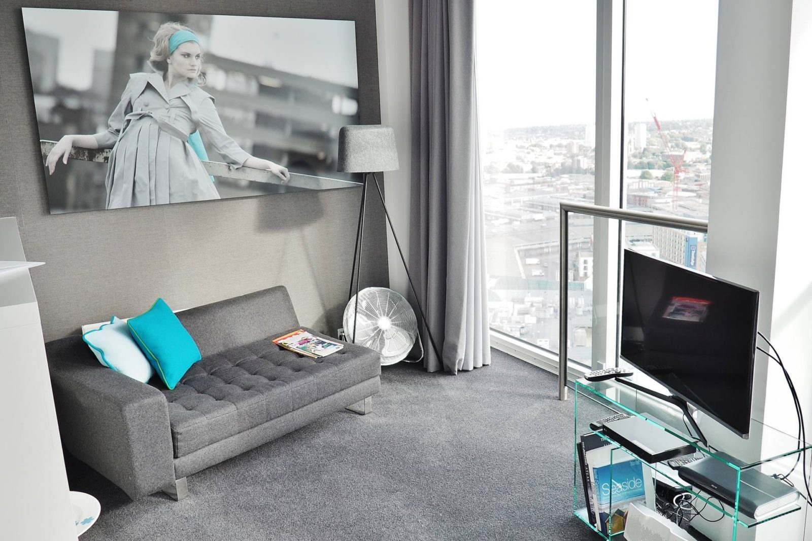 Emma Victoria Stokes Rotunda Apartment Lounge Sofa Art Work Television