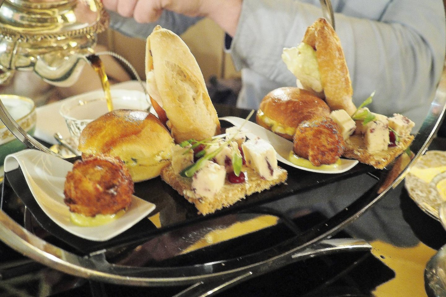 Emma Victoria Stokes Afternoon Tea Edgbaston Boutique Hotel Wensleydale with curry sauce on crostini bread - a haddock fish cake cemented with wasabi mayonnaise, served on a Japanese spoon - crispy bacon fresh tomato lettuce baguette and egg mayo brioche