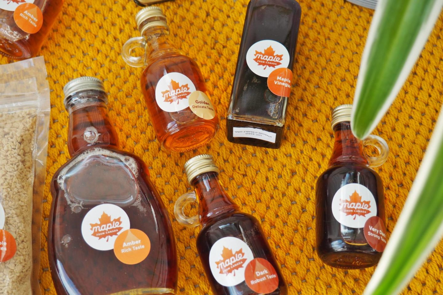 Selection of Maple Syrups lying down From Canada Bottle