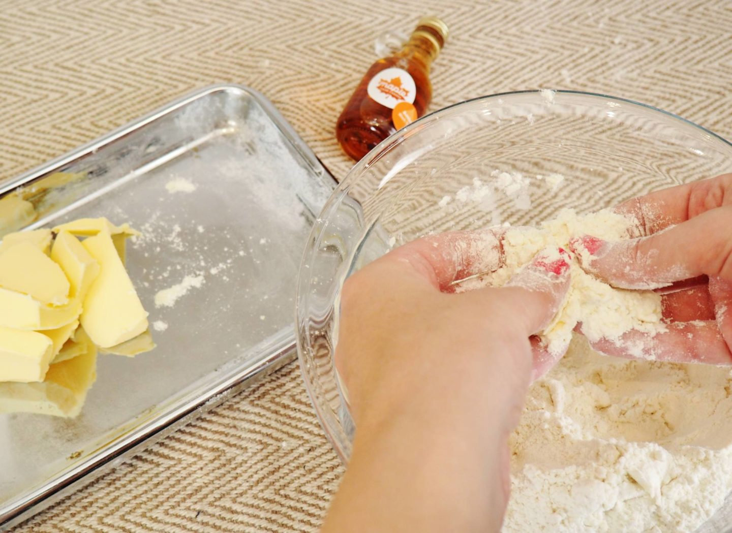 Maple Syrup From Canada Bottle - Mixing Dough with fingers