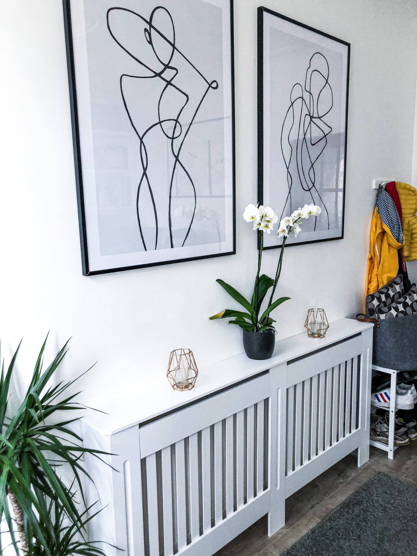 Desenio line art posters above a radiator cover